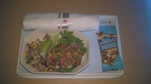 Cold chicken dish served aboard Air Canada flight.