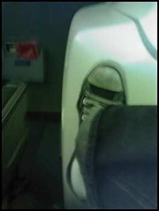 Feet in this picture are closer than they appear. 15F aboard a Delta 757-200 (75E)