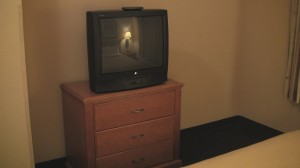 Small TV and dresser.