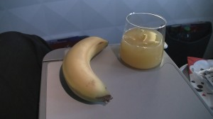 Banana and juice on a Delta 737-900