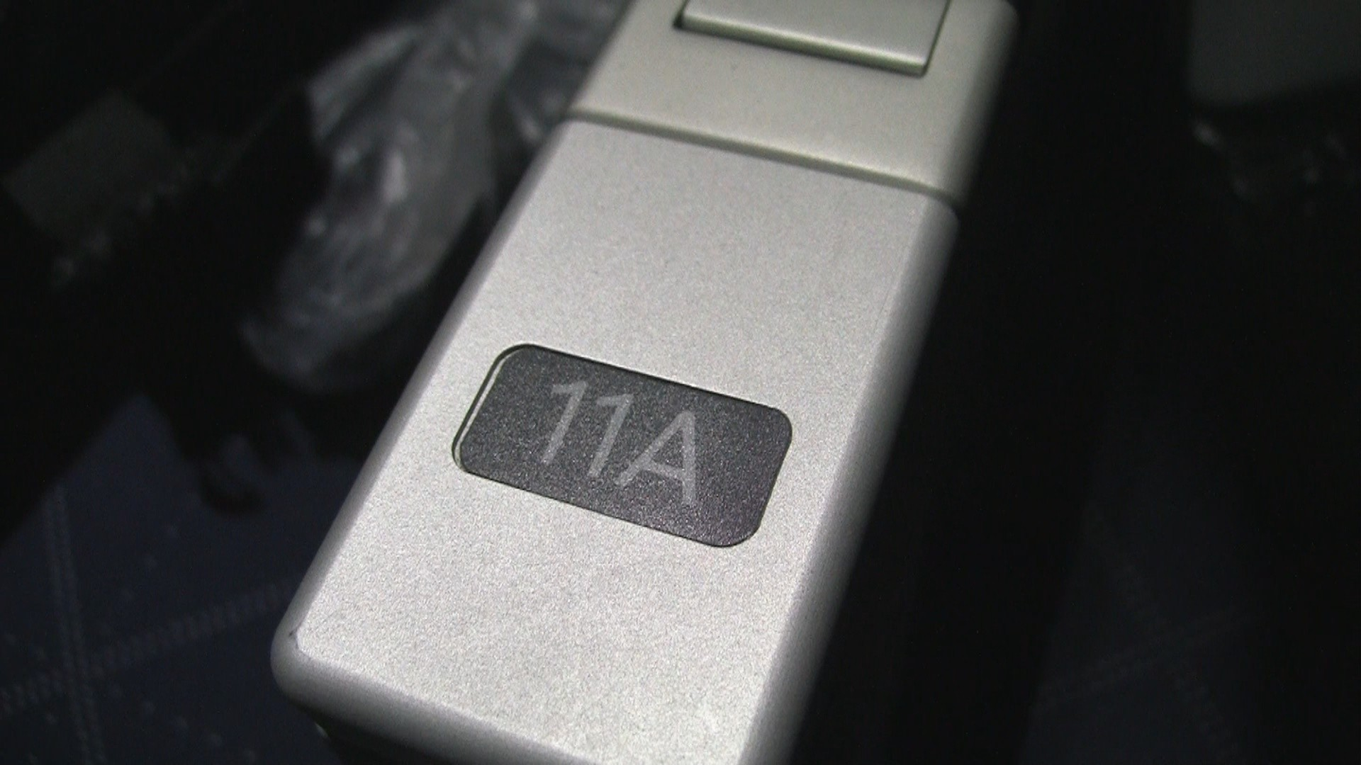 Seat 11A number printed in armrest.