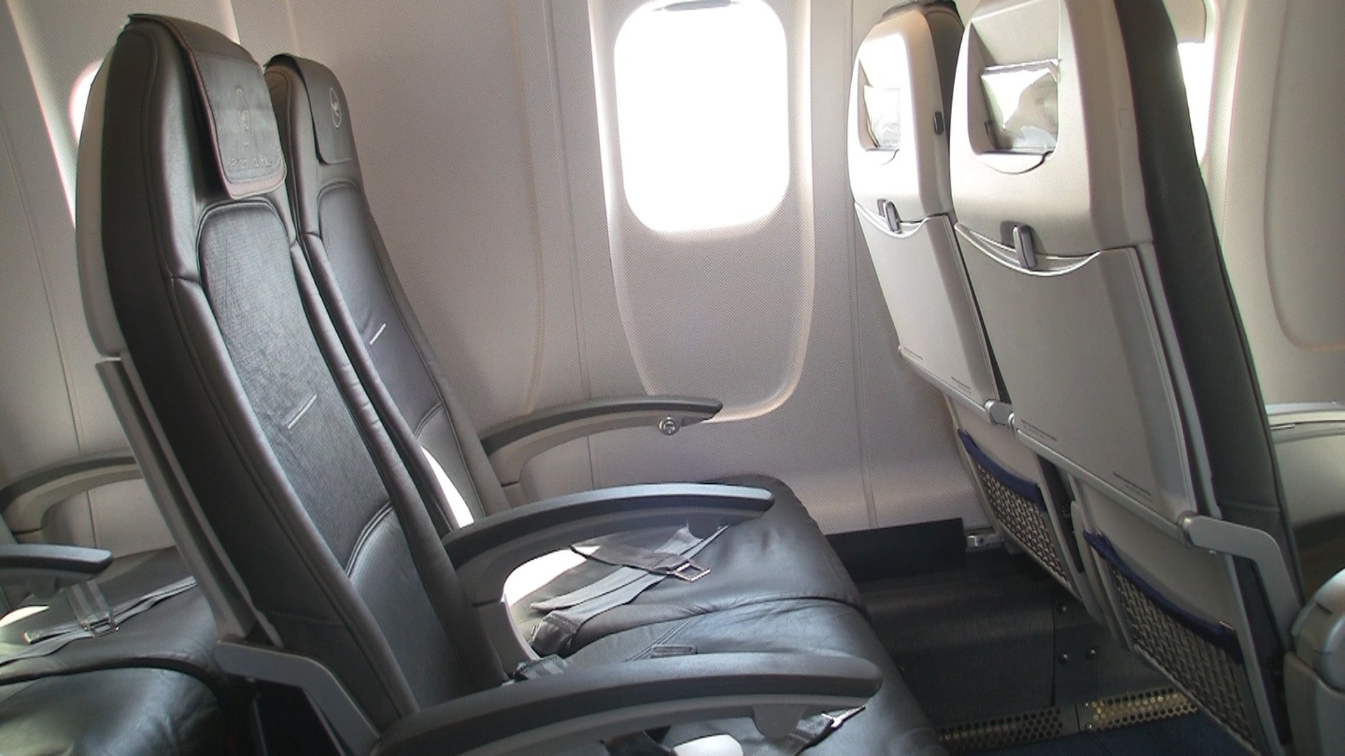 If your bags are overhead, you'll get more room to stretch in a non-bulkhead row.